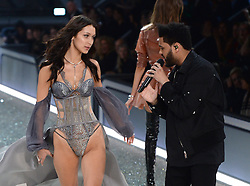 Bella Hadid and Abel Tesfaye aka The Weeknd on the catwalk during the Victoria's Secret Fashion Show 2016 held at The Grand Palais, Paris, France