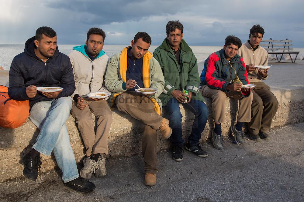 Mytilene, Lesvos, Greece - 04.03.2016        <br /> <br /> Pakistani refugees sitting at the port in Mytilene on the Aegean island Lesvos. A few days ago the Greek government stopped the registration of refugees from Pakistan, they are stucked now.<br /> <br /> Pakistanische Fluechtlinge am Hafen von Mytilini. Nachdem Griechenland wenige Tage zuvor aufgehoert hat pakistanischen Fluechtlinge zu registrieren stecken sie nun auf der Insel fest. <br /> <br /> Foto: Bjoern Kietzmann