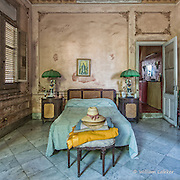 A bedroom area appears virtually untouched from the period in a once glamorous 1920's home in Havana's Vedado neighborhood