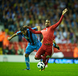 LIVERPOOL, ENGLAND - Thursday, August 19, 2010: Liverpool's David Ngog and Trabzonspor's Egemen Korkmaz during the UEFA Europa League Play-Off 1st Leg match at Anfield. (Pic by: David Rawcliffe/Propaganda)