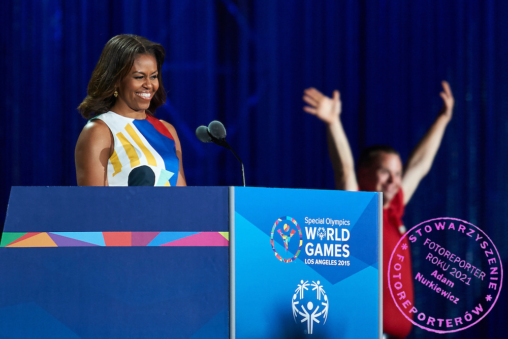 (L) Michelle Obama First Lady USA speaks during opening ceremony of the Special Olympics World Games Los Angeles 2015 at the Los Angeles Coliseum Stadium on July 25, 2015 in Los Angeles, USA.<br /> USA, Los Angeles, July 25, 2015<br /> <br /> Picture also available in RAW (NEF) or TIFF format on special request.<br /> <br /> For editorial use only. Any commercial or promotional use requires permission.<br /> <br /> Adam Nurkiewicz declares that he has no rights to the image of people at the photographs of his authorship.<br /> <br /> Mandatory credit:<br /> Photo by &copy; Adam Nurkiewicz / Mediasport