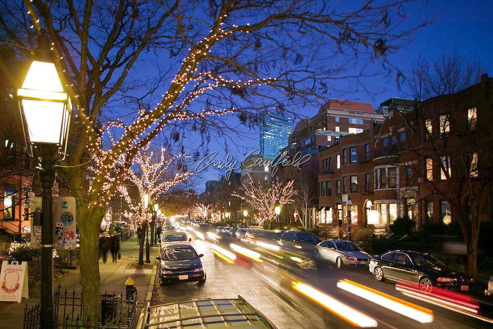 Newbury steet, popular retail and residential area of city at dusk with holiday lighting. Boston Massachusetts