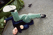 Mr C rolls on the pavement, on the way home from The End , London, 1990s.