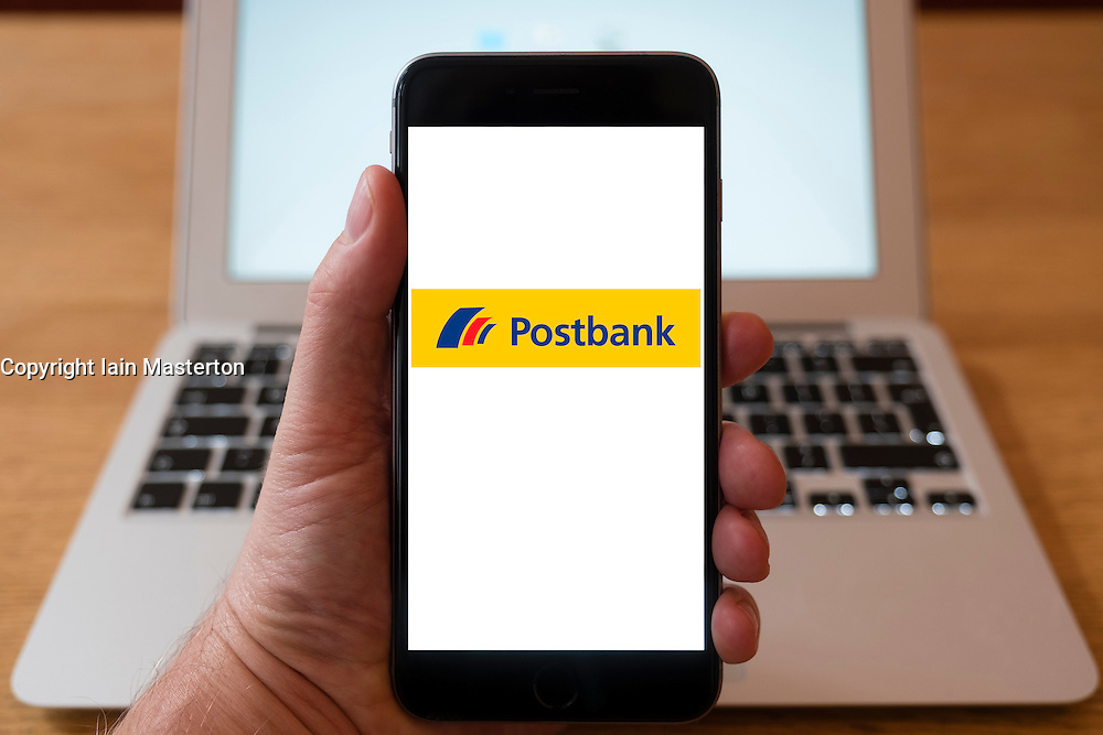 Using iPhone smartphone to display logo of Postbank, German retail Bank