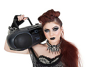 Portrait of punk woman holding boom box on shoulder over white background