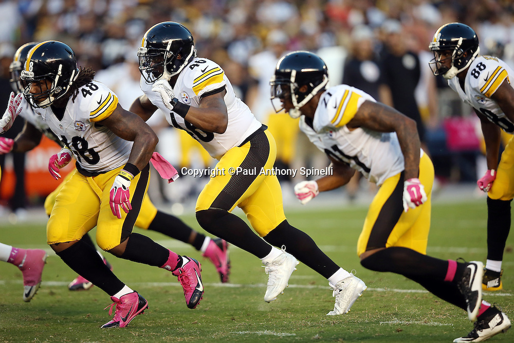 Pittsburgh Steelers linebacker Bud Dupree (48), Pittsburgh Steelers fullback Will Johnson (46), and Pittsburgh Steelers safety Robert Golden (21) rush during the 2015 NFL week 5 regular season football game against the San Diego Chargers on Monday, Oct. 12, 2015 in San Diego. The Steelers won the game 24-20. (©Paul Anthony Spinelli)