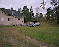Volvo 240..A Volvo 240 car is parked outside a house.