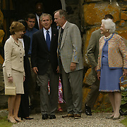 President Bush, center left, exits St. Agnes Church with first lady Laura Bush, left, father former President George H. W. Bush, and mother Barbara Bush Sunday, July 7, 2002, in Kennebunkport, Maine.  President Bush is spending the Independence Day weekend in Kennebunkport, Maine, home of his parents...Photo by Khue Bui