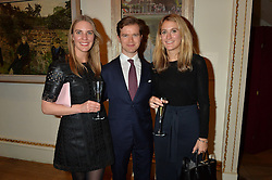 LONDON, ENGLAND 28 NOVEMBER 2016: Left to right, Rebecca Tooby-Desmond, Daniel Costelloe, Caroline Magnamaro at a reception to celebrate the publication of The Sovereign Artist by Christopher Le Brun and Wolf Burchard held at the Royal Academy of Art, Piccadilly, London, England. 28 November 2016.