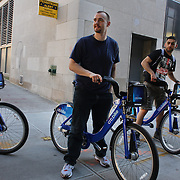 Citi Bike users in Manhattan, New York. Citi Bike the NYC Bicycle Share Program sponsored by Citi Bank, launched in late May 2013 giving access to thousands of bikes at docking stations throughout  Manhattan and parts of Brooklyn. Manhattan, New York, USA. 4th June 2013. Photo Tim Clayton