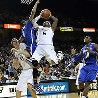 Central Florida guard Marcus Jordan (5) drives to the basket against Memphis guard Charles Carmouche (4) during a Conference USA NCAA basketball game between the Memphis Tigers and the Central Florida Knights at the UCF Arena on February 9, 2011 in Orlando, Florida. Memphis won the game 63-62. (AP Photo: Alex Menendez)