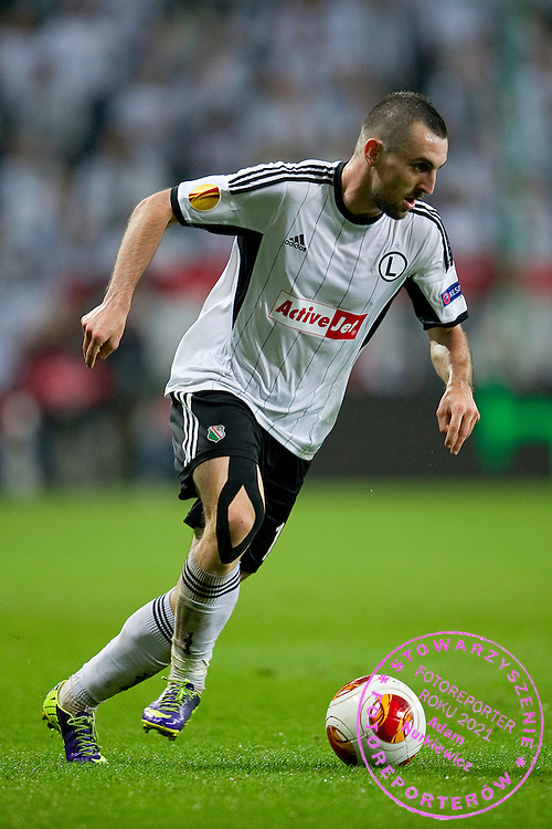 Legia's Michal Kucharczyk controls the ball during the UEFA Europa League Group J football match between Legia Warsaw and Trabzonspor AS at Pepsi Arena Stadium in Warsaw on November 07, 2013.<br /> <br /> Poland, Warsaw, November 07, 2013<br /> <br /> Picture also available in RAW (NEF) or TIFF format on special request.<br /> <br /> For editorial use only. Any commercial or promotional use requires permission.<br /> <br /> Mandatory credit:<br /> Photo by &copy; Adam Nurkiewicz / Mediasport