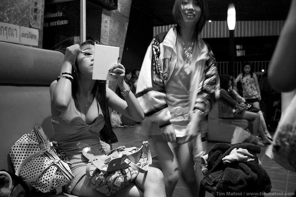 From 7-9pm young women, ages 15 to 22, prepare for a night of work at the Violin Karaoke bar in Chiang Mai, Thailand. Their job is to sell drinks to customers who book the karaoke rooms; in the neighboring dance club, also part of the Violin, there are cocktail waitresses. However, many are also freelance sex workers or 'bar girls' who make their own arrangements with the customers for a 'date.' Most of the customers are asian; they are either Thai, Korean, Chinese, or Japanese.