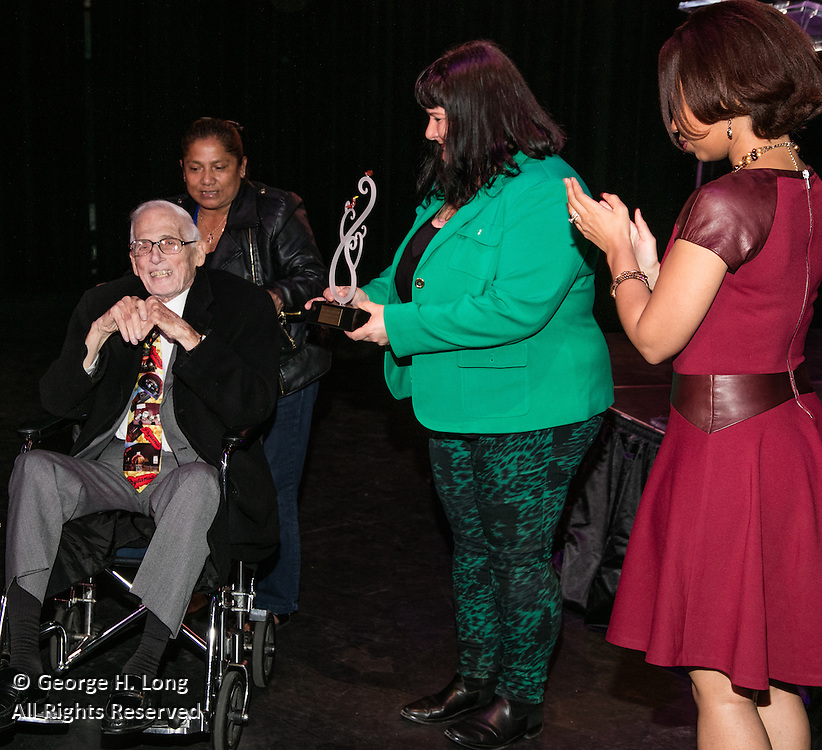 Movie theater owner Rene' Brunet Jr. receives his award at the Arts Council New Orleans Community Arts Awards Celebration at the Civic Theatre December 2, 2015