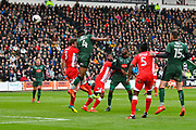 Yann Songo'o (4) of Plymouth Argyle shoots at goal with a header during the EFL Sky Bet League 2 match between Plymouth Argyle and Accrington Stanley at Home Park, Plymouth, England on 1 April 2017. Photo by Graham Hunt.