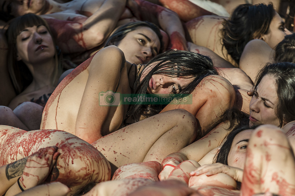 December 11, 2016 - Naked animal rights activists covered with fake blood denounce the use of animal skins and fur during one of the most impacting animal rights protests staged in Barcelona (Credit Image: © Matthias Oesterle via ZUMA Wire)