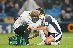 MANCHESTER, ENGLAND - WEDNESDAY, JANUARY 4th, 2006: Tottenham Hotspur's Mido is treated for an ear injury during the Premiership match against  Manchester City at the City of Manchester Stadium. (Pic by David Rawcliffe/Propaganda)