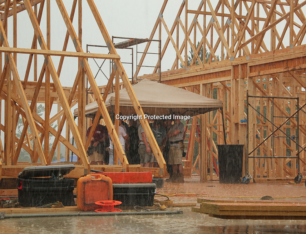 Although the heavy rainfall early in the week didn't slow down construction too much, there were times when workers had to duck out and wait for the deluge to lighten.