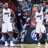 19 November 2010: Miami Heat's small forward #6 LeBron James and Miami Heat's shooting guard #3 Dwyane Wade rest during the Miami Heat 95-87 victory over the Charlotte Bobcats at the AmericanAirlines Arena, Miami, Florida, USA.