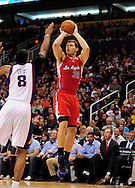 Apr. 1, 2011; Phoenix, AZ, USA; Los Angeles Clippers forward Blake Griffin (32) puts up a shot against the Phoenix Suns forward Channing Frye (8) at the US Airways Center. Mandatory Credit: Jennifer Stewart-US PRESSWIRE