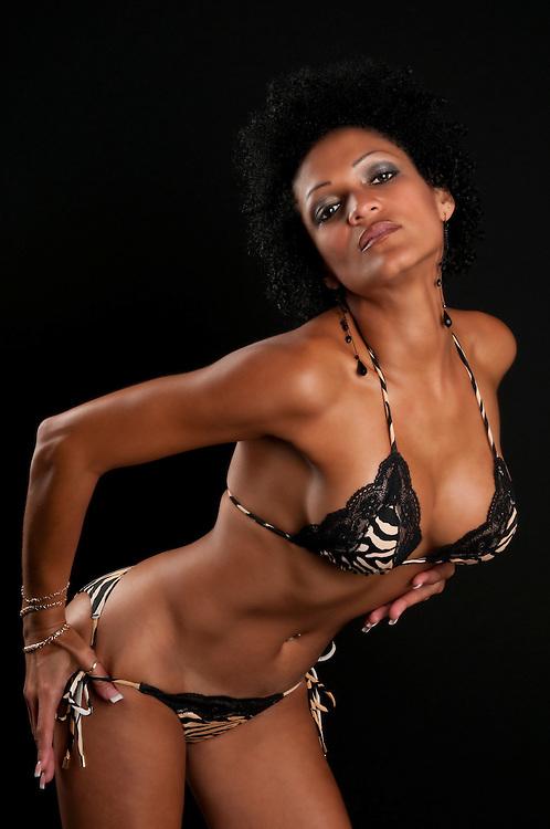30 Something very sensual hispanic brunette woman in bikini.