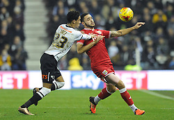 Derrick Williams of Bristol City is challenged by Thomas Ince of Derby County - Mandatory byline: Dougie Allward/JMP - 15/12/2015 - Football - iPro Stadium - Derby, England - Derby County v Bristol City - Sky Bet Championship