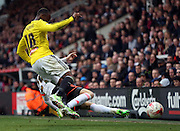 James Husband tacklingMoses Odubajo, brutal tackle during the Sky Bet Championship match between Fulham and Brentford at Craven Cottage, London, England on 3 April 2015. Photo by Matthew Redman.