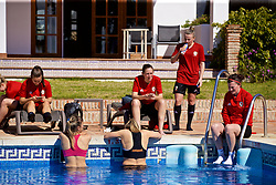 ALHAURÍN EL GRANDE, SPAIN - Tuesday, February 26, 2019: Wales players cool off in the water of the hotel swimming pool during a training session at the at Alhaurin Golf Resort in Spain. Cori Williams, Kylie Nolan and Helen Ward. (Pic by David Rawcliffe/Propaganda)