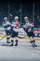 KELOWNA, CANADA - NOVEMBER 11: Braydyn Chizen #22, Nolan Foote #29 and Cal Foote #25 of the Kelowna Rockets take part in a pre-game ritual against the Red Deer Rebels on November 11, 2017 at Prospera Place in Kelowna, British Columbia, Canada.  (Photo by Marissa Baecker/Shoot the Breeze)  *** Local Caption ***