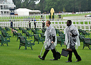 © licensed to London News Pictures. ASCOT, UK.  16/06/11. Ground staff wear raincoats.  Ladies Day at Royal Ascot 16 June 2011. Royal Ascot has established itself as a national institution and the centrepiece of the British social calendar as well as being a stage for the best racehorses in the world. Mandatory Credit Stephen Simpson/LNP