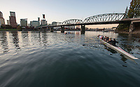 Rowers practice under the Portland Skyline and Hawthorne Bridge<br /> <br /> Shot in Portland, OR, USA