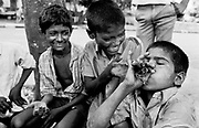 may 1991, India, Bombay, near Victoria Terminus, streetchildren smoking, position: sheet n° 12 © ISABELLA BALENA www.isabellabalena.com