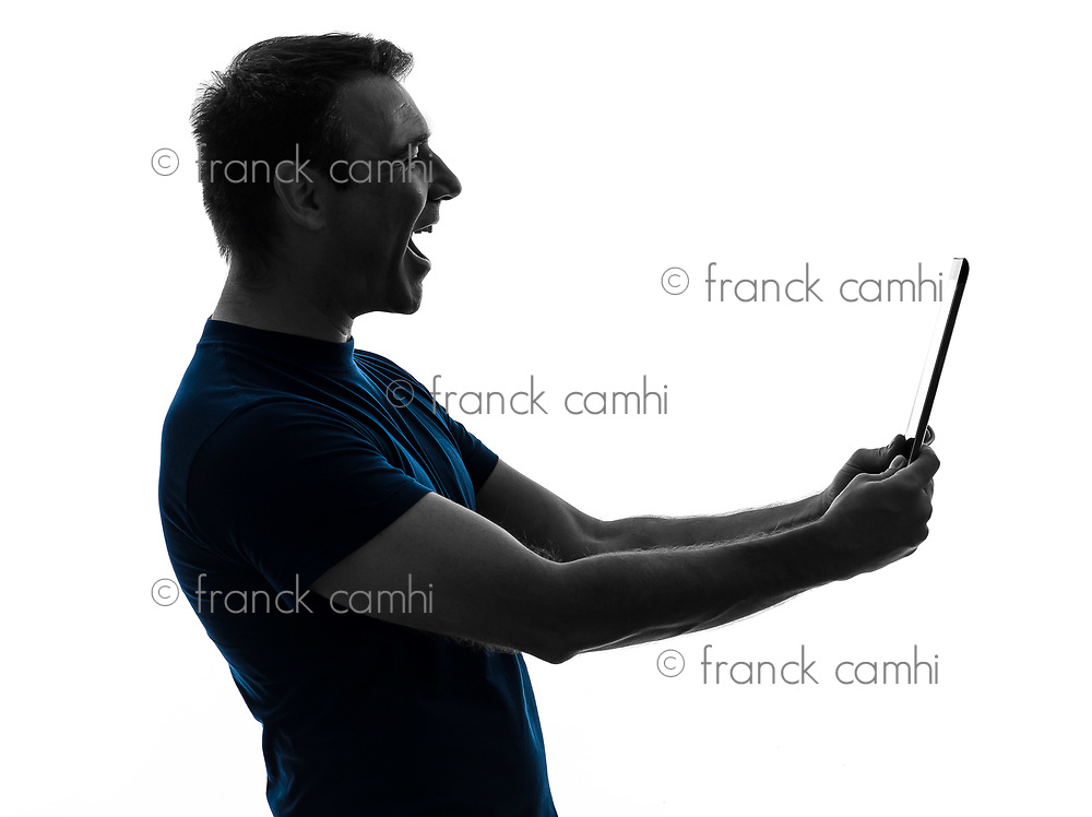 one  man holding digital tablet laughing portrait on white background