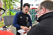 Adam Smith (15) of AFC Bournemouth signing autographs on arrival before the Premier League match between Bournemouth and Tottenham Hotspur at the Vitality Stadium, Bournemouth, England on 4 May 2019.