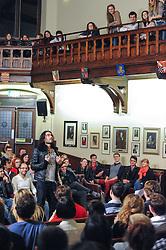 "Russell Brand at Cambridge Union, Cambridge, United kingdom, Monday, 13th January 2014. Picture by Chris Williamson / i-Images<br /> <br /> Comedian Russell Brand told students at Cambridge University that he has not ruled out running for parliament.<br /> <br /> The actor and TV star, who was speaking in front of a packed audience of 800 students at the historic Cambridge Union, said: ""Why do I have to run? I'll saunter for office!""<br /> <br /> Brand controversially called his audience ""Harry Potter Poofs"" as he tried to get them to keep quiet.<br /> <br /> ""Shut up you Harry Potter Poofs,"" he said, but it was met with laughter from the students.<br /> Picture by Chris Williamson / i-Images"