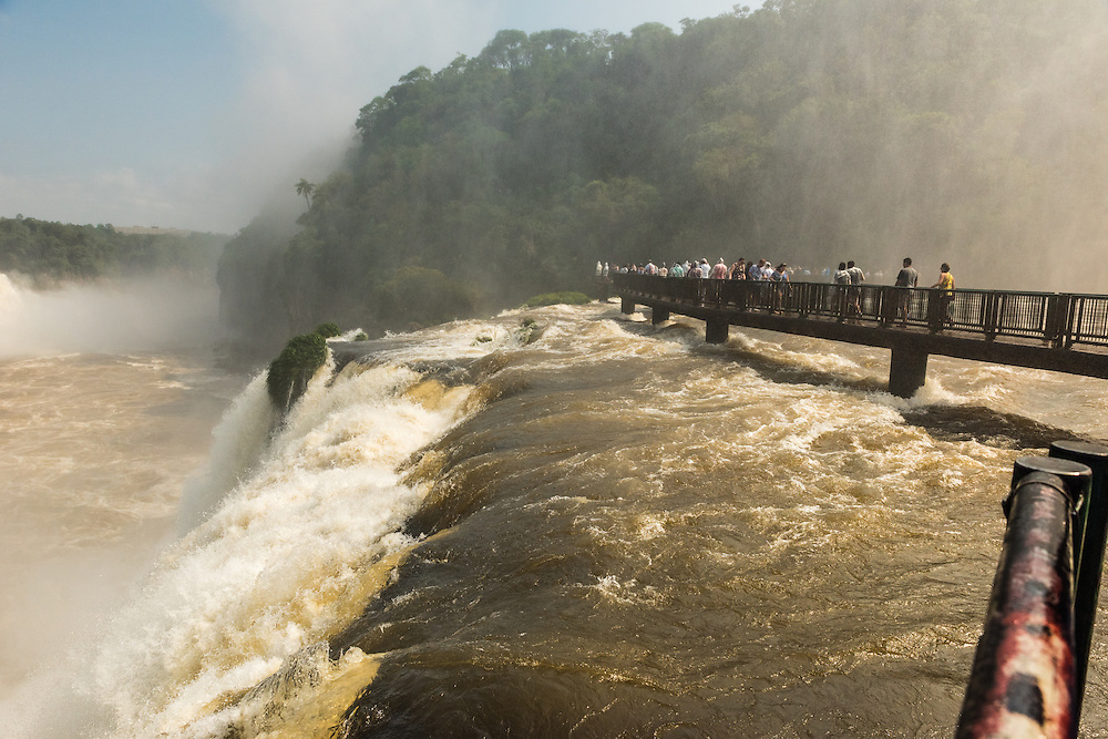 Bridge with people in Garganta del Diablo, Iguazu Falls. Foz do Iguazu, Brazil.
