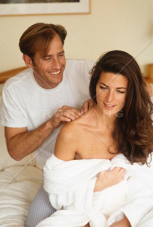 Woman receiving a Playful massage by a man
