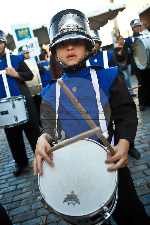 A young drummer parades at the Festival of San Sebastian in San Juan, Puerto Rico.