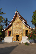 A late afternoon view of the royal funerary carriage house at Wat Xieng Thong, Luang Prabang. Inside is the funeral carriage, which stands 36ft. high. Wat Xieng Thong is considered one of the most important monasteries in Laos and has over twenty structures on the grounds.