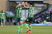 Rhys Murphy forward for AFC Wimbledon (39) congratulates Lyle Taylor forward for AFC Wimbledon (33) after he puts AFC Wimbledon 0-1 up during the Sky Bet League 2 match between Wycombe Wanderers and AFC Wimbledon at Adams Park, High Wycombe, England on 2 April 2016. Photo by Stuart Butcher.