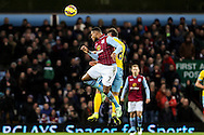 Leandro Bacuna of Aston Villa (left)  clears during the Barclays Premier League match at Villa Park, Birmingham<br /> Picture by Andy Kearns/Focus Images Ltd 0781 864 4264<br /> 01/01/2015
