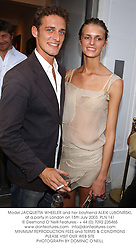 Model JACQUETTA WHEELER and her boyfriend ALEXI LUBONIRSKI, at a party in London on 15th July 2003.PLN 141