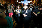 Nathan Pim, right of center, marches with anti-GOP demonstrators participate in a dance party flash mob through the streets of Ybor City during the 2012 Republican National Convention in Tampa, Fla.