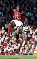 Photo: Ed Godden.<br />Arsenal v Aston Villa. The Barclays Premiership. 01/04/2006. Arsenals Kolo Toure leaps high for the ball.