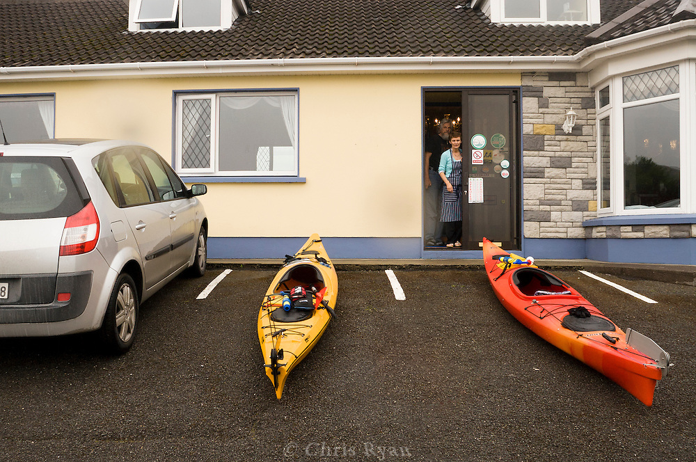Kayaks parked at a bed and breakfast in County Kerry, Ireland