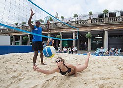 Image ©Licensed to i-Images Picture Agency. 30/07/2014. London, United Kingdom. Zara Dampney and Lucy Boulton take part in a pop up beach volleyball event.<br /> Pic Shows Zara Dampney (dark hair) and Lucy Boulton (blonde) playing. Picture by i-Images