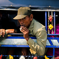 Soldier smoking in Tuk Tuk, Muang Singh, Laos
