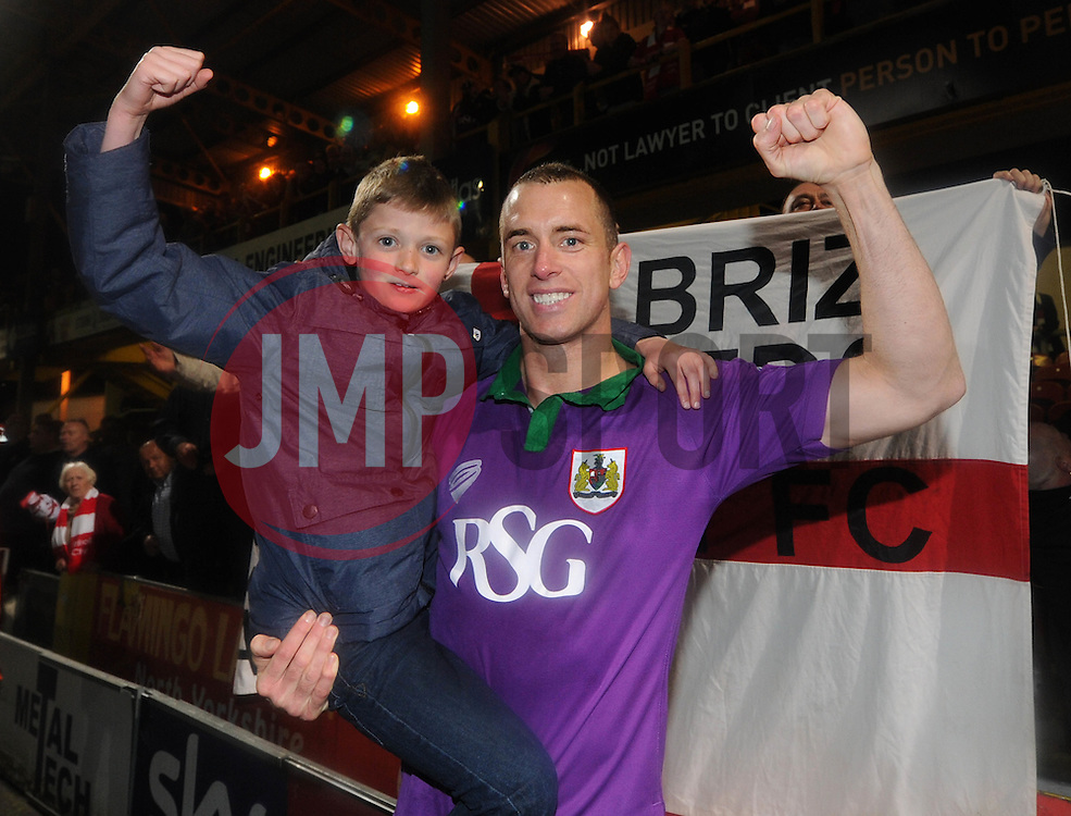 Bristol City's Aaron Wilbraham poses with a young fan after beating Bradford City 0-6 to win promotion to the Sky Bet Championship - Photo mandatory by-line: Dougie Allward/JMP - Mobile: 07966 386802 - 14/04/2015 - SPORT - Football - Bradford - Valley Parade - Bradford City v Bristol City - Sky Bet League One