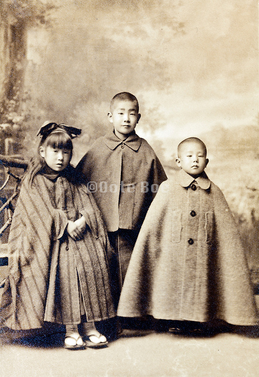 little children wearing capes in vintage studio portrait Japan