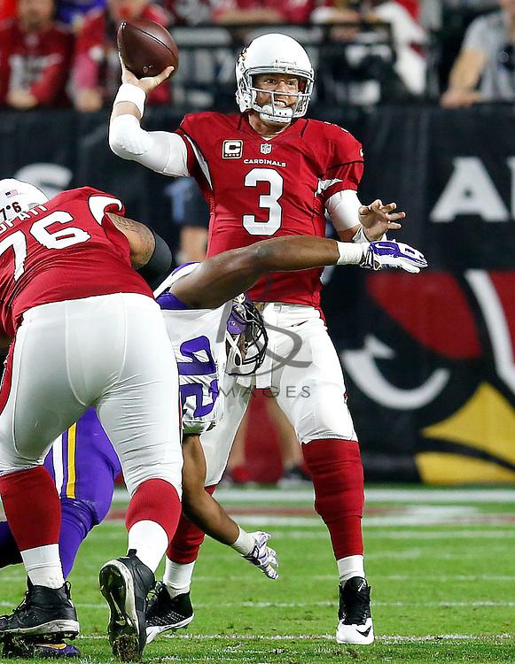 Arizona Cardinals quarterback Carson Palmer (3) throws against the Minnesota Vikings during the first half of an NFL football game, Thursday, Dec. 10, 2015, in Glendale, Ariz. (AP Photo/Rick Scuteri)